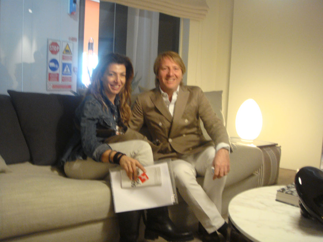 Andrea Parisio designer of the latest lines of Meridiani with Christiana at the Meridiani Stand in the Milan Furniture Show.