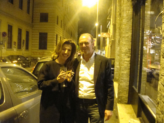 At the BAXTER party Designer Giuseppe Manzoni and Chrisitana Markidou having a cigarette outside. No smoking inside in Milan.